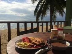 Bacon, watermelon, mango, scrambled eggs, fryjacks and beans.