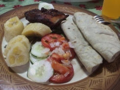 Chicken, salad, tortillas and plantains.