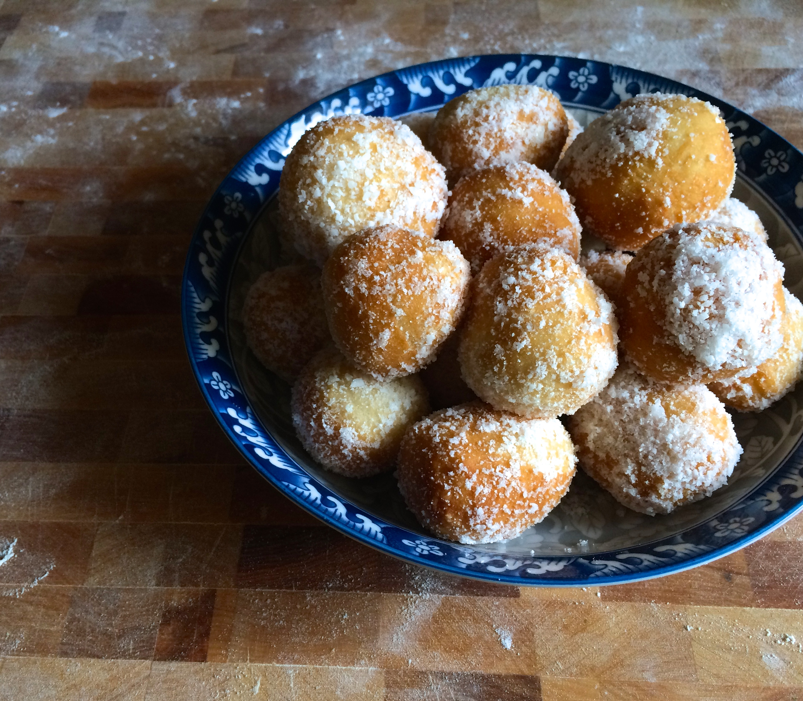 zeppoles with granulated white sugar and coconuts